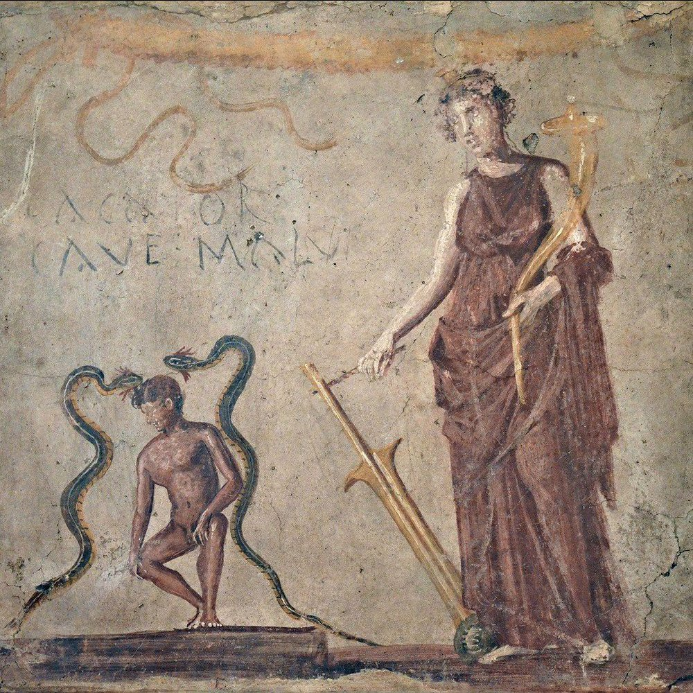 "The goddess Fortuna (or perhaps Venus of Pompeii) and two lucky snakes protect a naked youth squatting to poo. CACATOR CAVE MALUM means ""man doing a poo, beware evil!"" From the National Archaeological Museum in Naples."