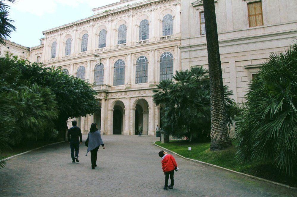 The entrance to one of the best kept secrets in Rome: The Palazzo Barberini and its beautiful small back garden and amazing art and classical antiquity museum inside.    Palazzo Barberini  Via delle Quattro Fontane, 13 00186 Roma