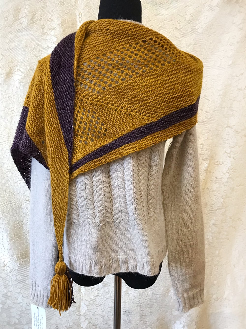 Ravenhill - Tamy Gore's Ravenhill shawl design is finished, and I even made the tassels! The shape is a shallow elongated triangle, and the method of construction is semi-modular, which makes it a fun knit.