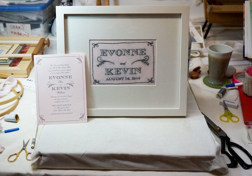 The finished, framed piece with the original wedding invitation