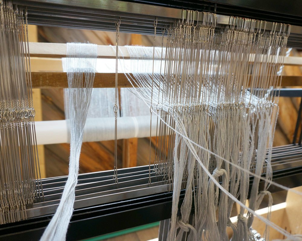 Threading the heddles