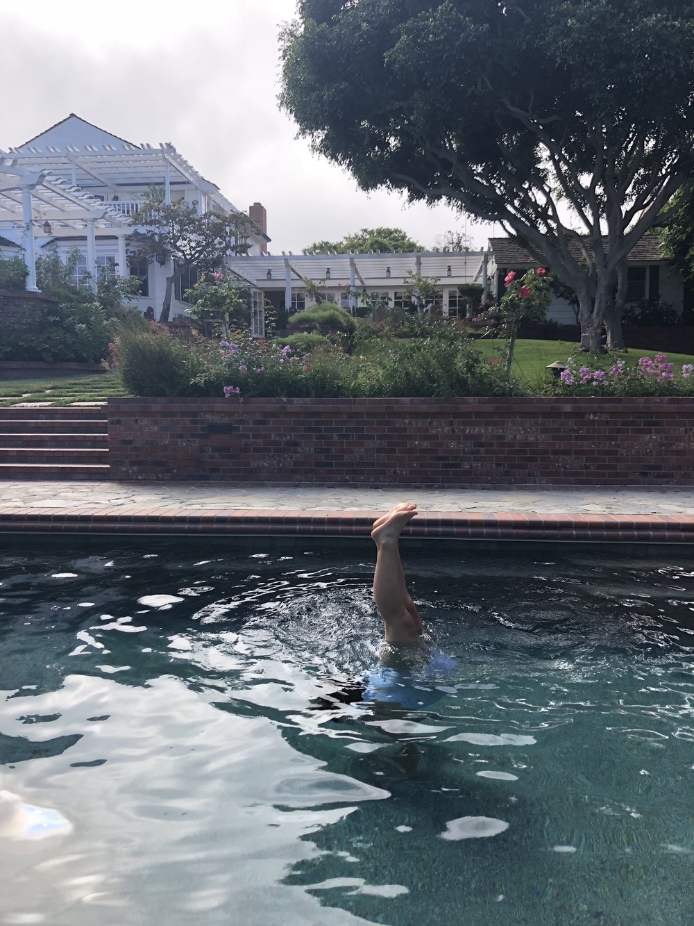 so many handstands and flips in my parents' pool! trying everything to flip that baby!