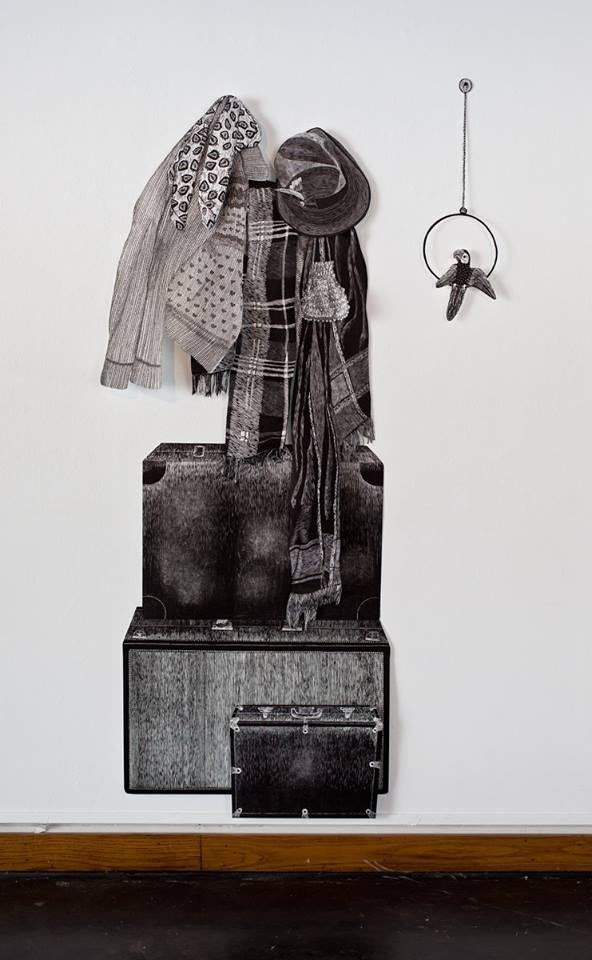 """""""Totem of Belongings"""", mixed media of pen drawings and linoleum relief, 20x69. Each piece is hand cut out with Xacto."""