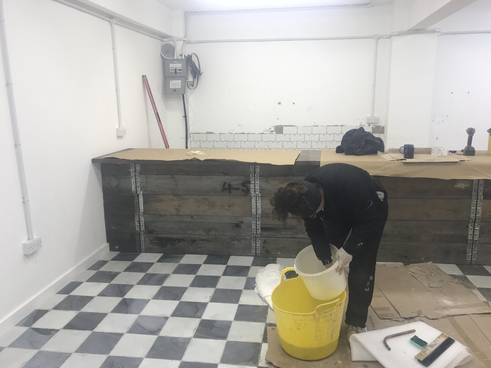 Cafe new flooring and wall tiles started