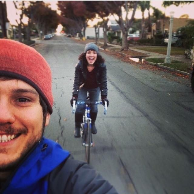 Riding our bikes to our first home together, a little studio in downtown Fullerton circa 2014.