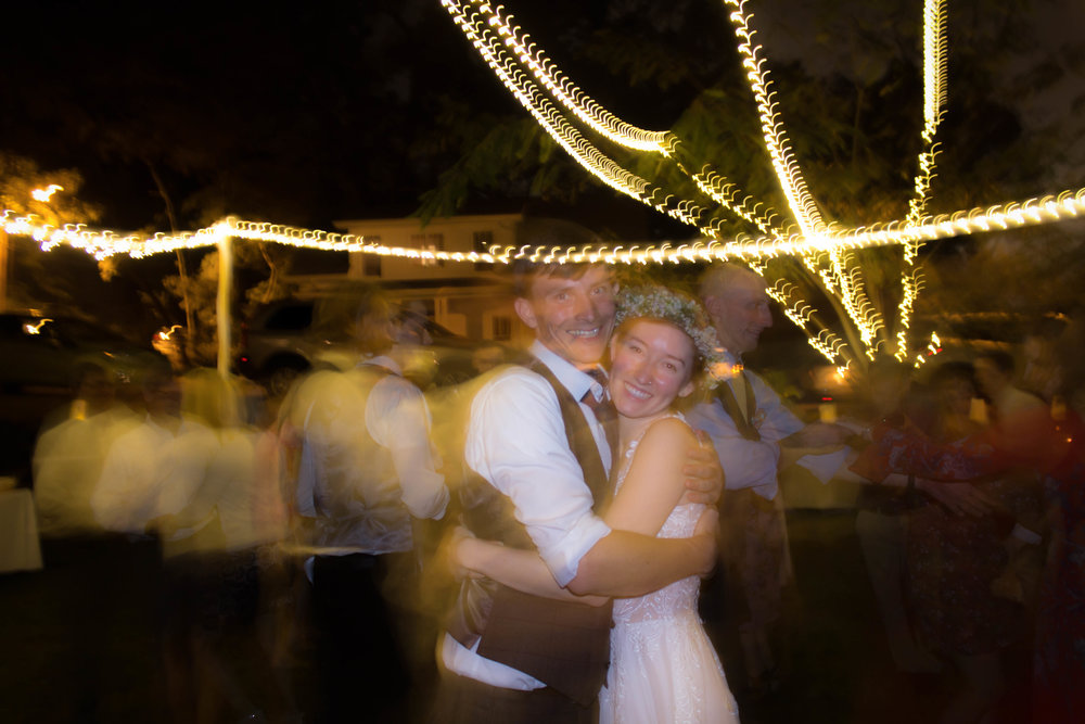 A quick embrace in the midst of swirling and spinning across the dance floor with family and friends.