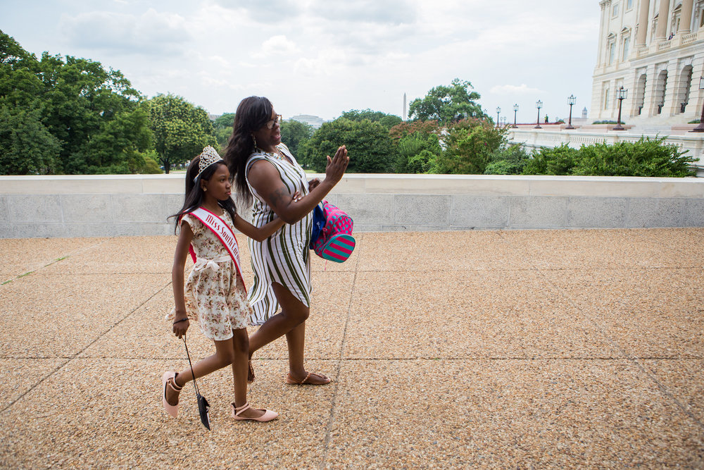 Tymia and her mother, Susie Pitts, head to the U.S. Capitol last week to lobby South Carolina lawmakers on health care, particularly the importance of Medicaid. (Liam James Doyle/NPR)