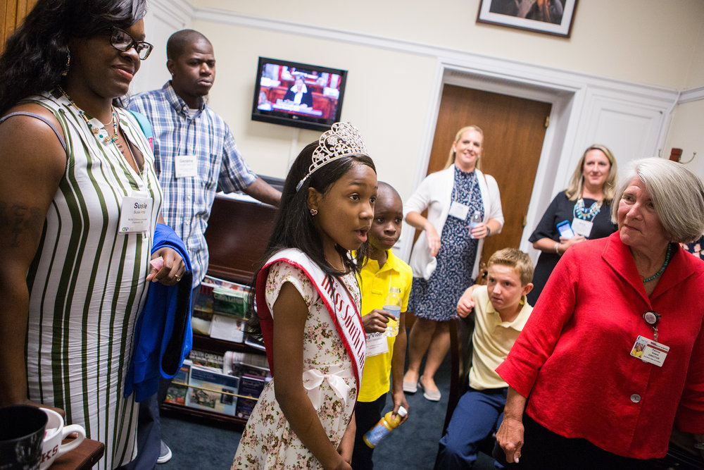 Tymia enters the office of South Carolina Rep. Mark Sanford, a Republican, as part of a lobbying trip organized by the Children's Hospital Association. (Liam James Doyle/NPR)