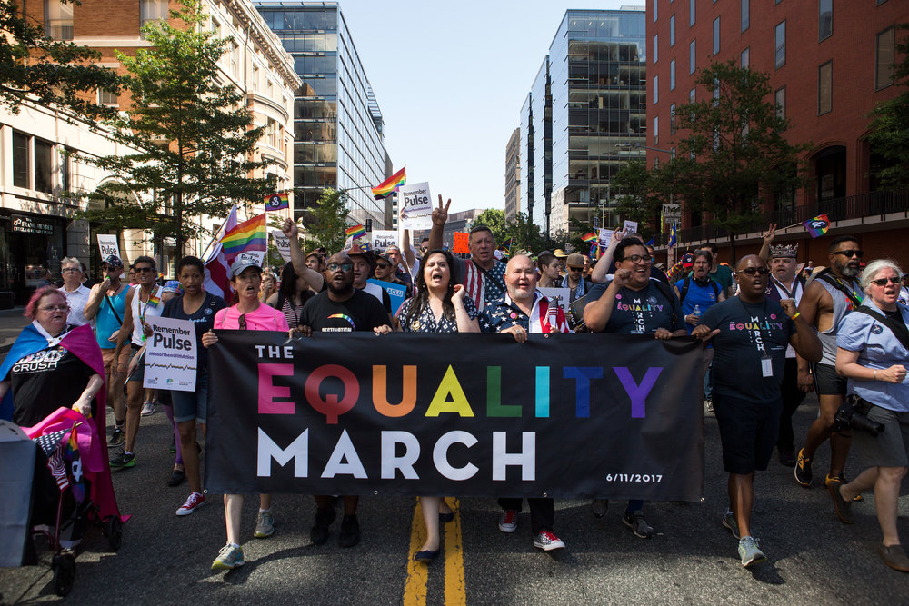Demonstrators at the front of the crowd lead thousands of others down 17th St. NW during the Equality March in Washington D.C. on Sunday, June 11. (Photo: Liam James Doyle/NPR)