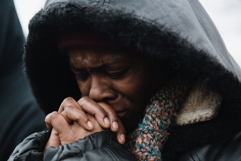 Daphne Brown, 43, of Brooklyn Park prayed alongside community members at the BlacksGiving event outside of the Minneapolis 4th Precinct on Thanksgiving Day, 2015.