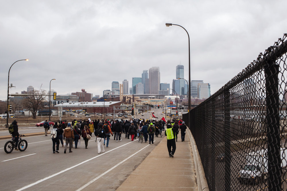 Demonstrators walk down N 7th St. towards downtown Minneapolis on Wednesday, March 30, 2016.