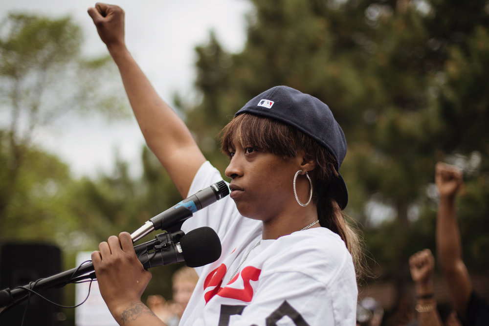 Diamond Reynolds speaks to a vast crowd outside of J. J. Hill Montessori School in St. Paul on Thursday, July 7, 2016. Less than 24 hours prior on Wednesday night, Reynolds broadcasted live video via Facebook the shooting of her boyfriend Philando Castile in Falcon Heights, when they were stopped by police in their car. Castile was an employee of the school, where he worked as a cafeteria supervisor.