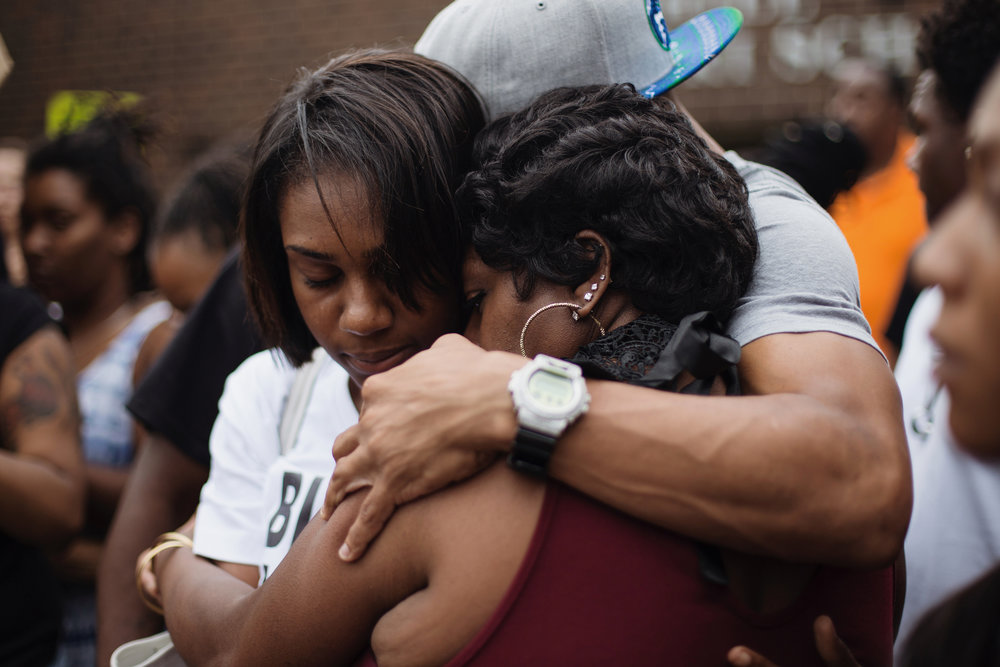 Valerie Castile, mother of Philando Castile, is embraced after speaking outside of J. J. Hill Montessori School in St. Paul on Thursday, July 7, 2016. Castile was an employee of the school, where he worked as a cafeteria supervisor.