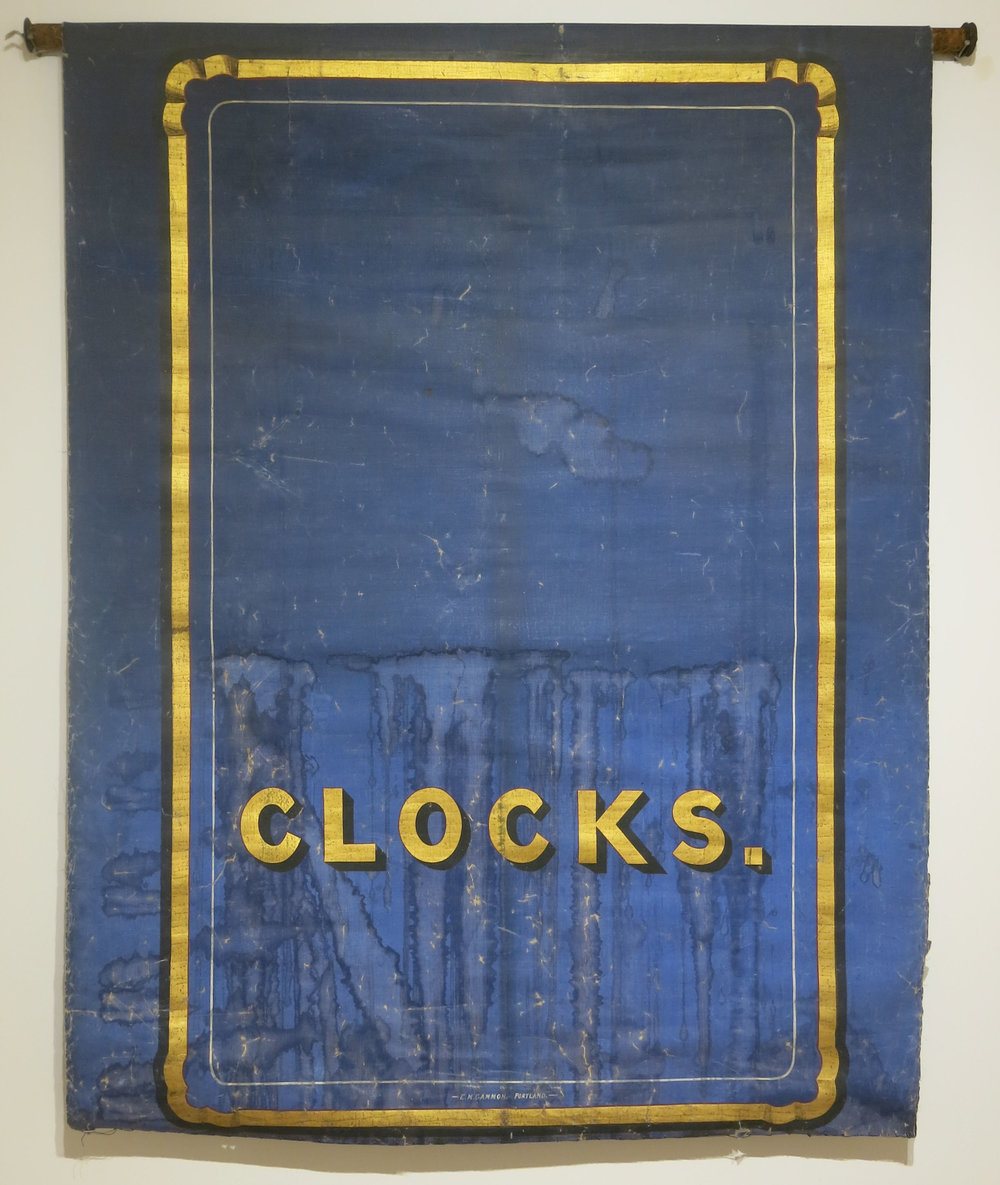 E. M. Gammon,  Clocks (exterior storefront window shade Portland, Maine) , 1890, hand sign painted with gold leaf on canvas, 64h x 52w in.