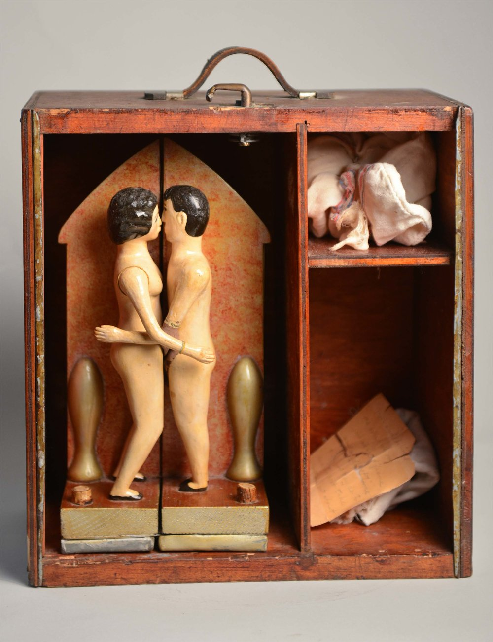 Anonymous, American,  Sex Toy,  c. 1930, carved and painted wood with paper, metal and fabric; original case, 40h x 30w x 4d in.