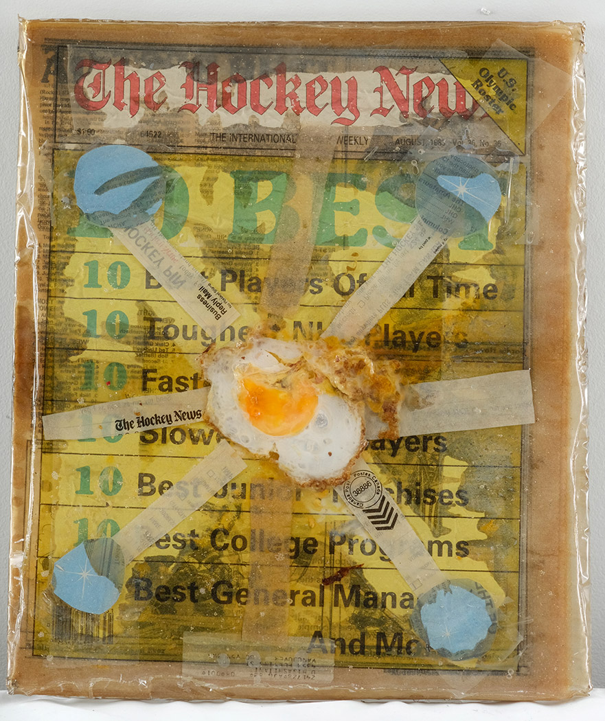 Mark DeLong,  The Egg of Aquarius , 2014, paper, mixed media and resin on newspaper, 16.25h x 14w in.