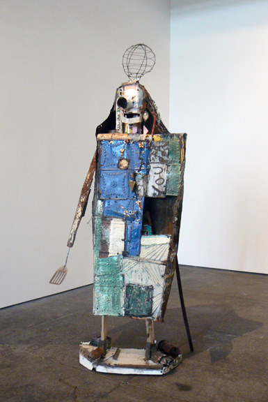 Matthew Blackwell,  Picklelilly,  2013, wood, sheet metal, canned goods, wire, 66h x 25.5w x 16.5d in. 9with stand and cane)