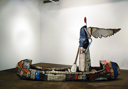 Matthew Blackwell,  Crossing Over,  tin, metal studs, enamel, and mixed media, 76.5h x 130w x 32d in.