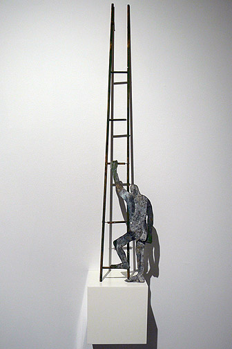 June Leaf,  Figure Climbing Ladder,  2011, tin and wood, 36.5h x 7w x 2d in.