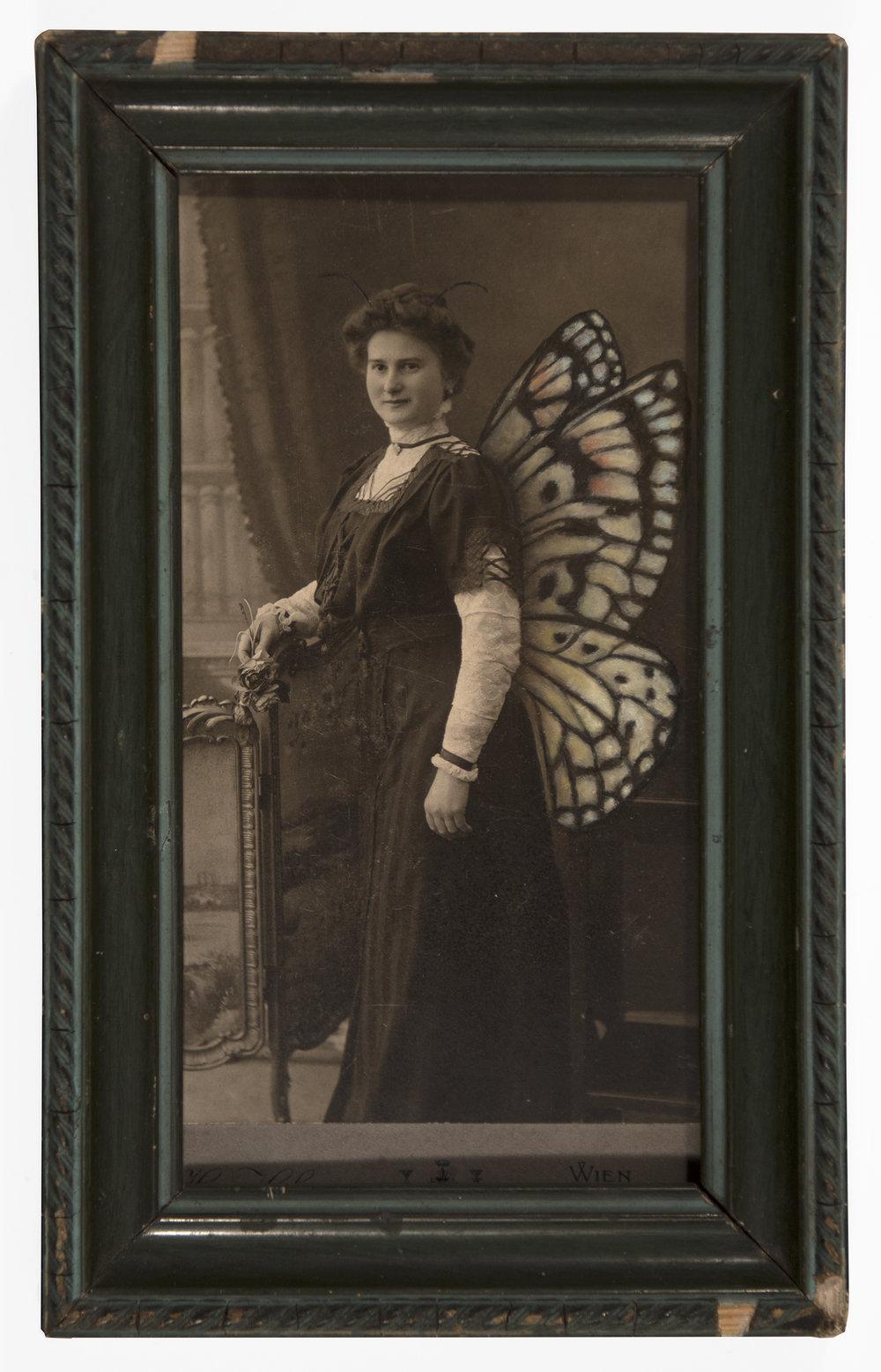 Jana Paleckova,  untitled (butterfly woman by window),  2017, oil paint on vintage photograph, 9h x 5 1/2w in.