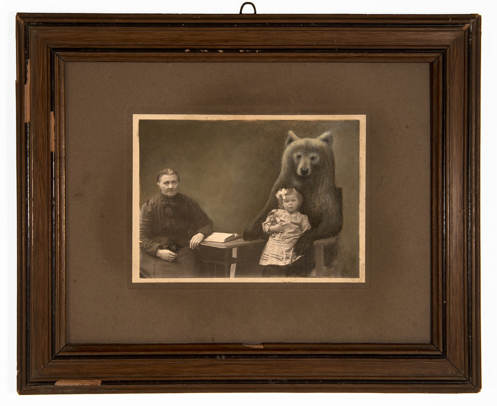 Jana Paleckova,  untitled (child in bears lap),  2017, oil paint on vintage photograph, 9h x 5 1/2w in.