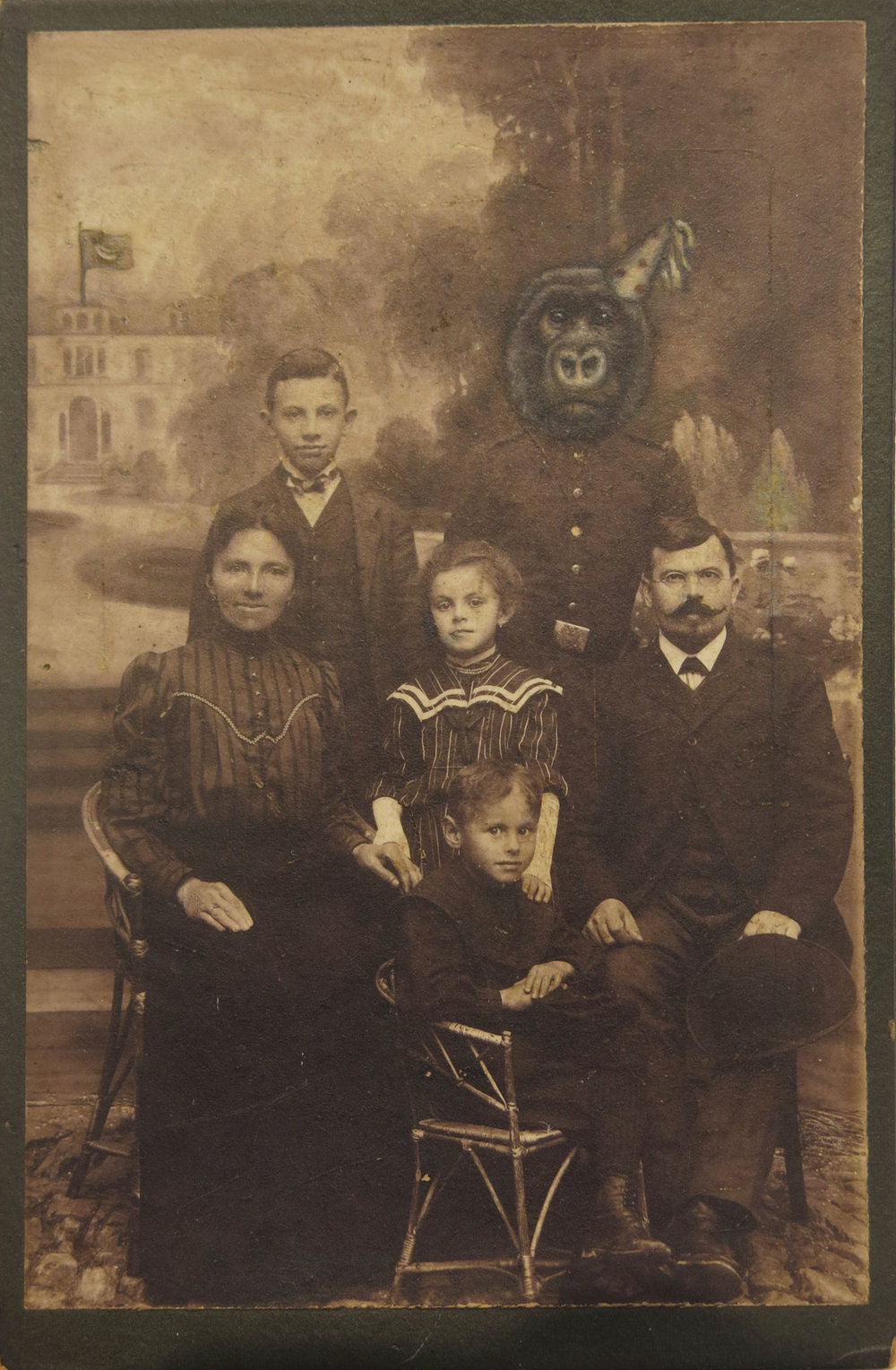 Jana Paleckova,  untitled 9gorilla with birthday hat),  2016, oil paint on vintage photograph, 6 1/2h x 4 1/4w in.