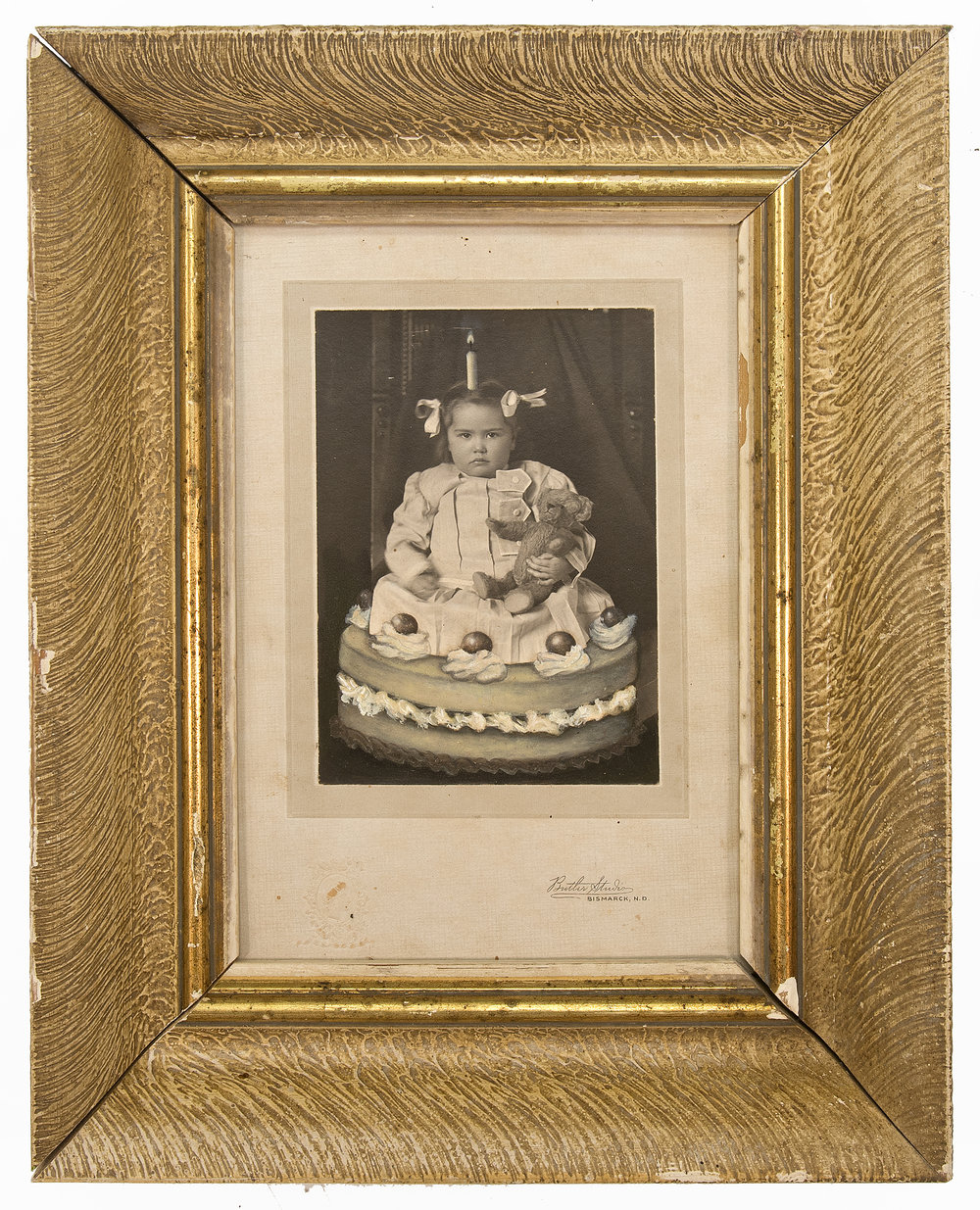 Jana Paleckova,  untitled (little girl in cake),  2017, oil paint on vintage photograph, 9 1/4h x 9 1/4w in.