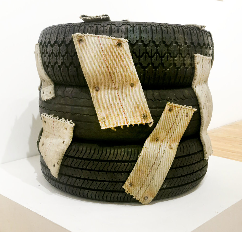 Nari Ward,  Nanny, Nanny, Nanny,  1993, tires, nylon straps, and dry wall screws, 23h x 26w x 26d in.