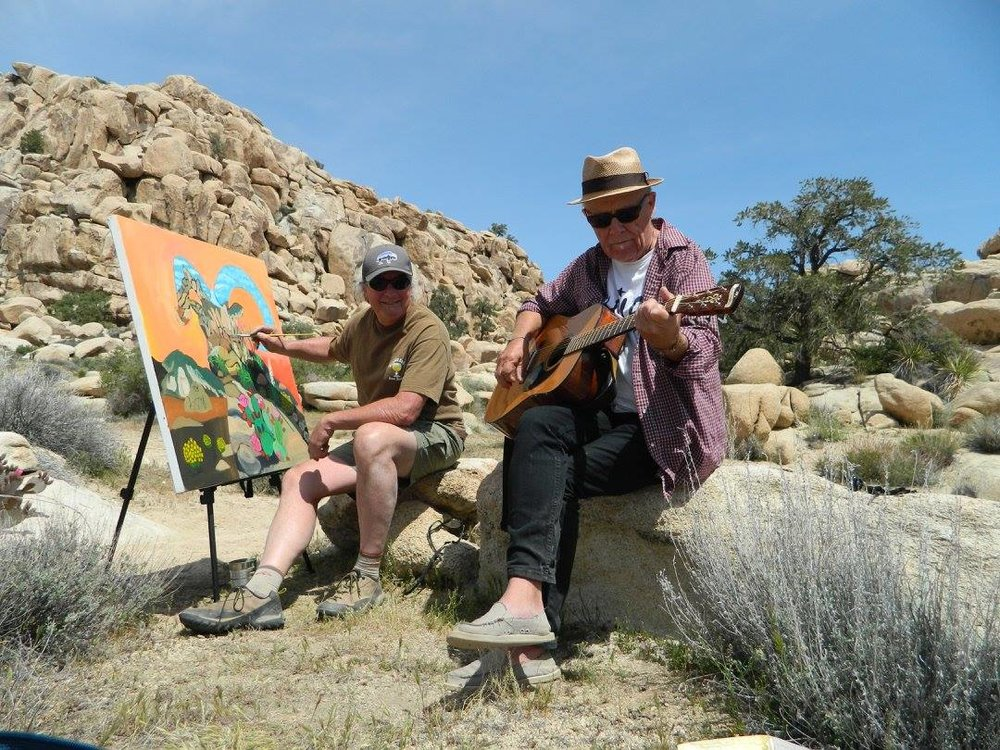 Artist Jude Bischoff and Johnnie Mac painting and singing in Joshua Tree.