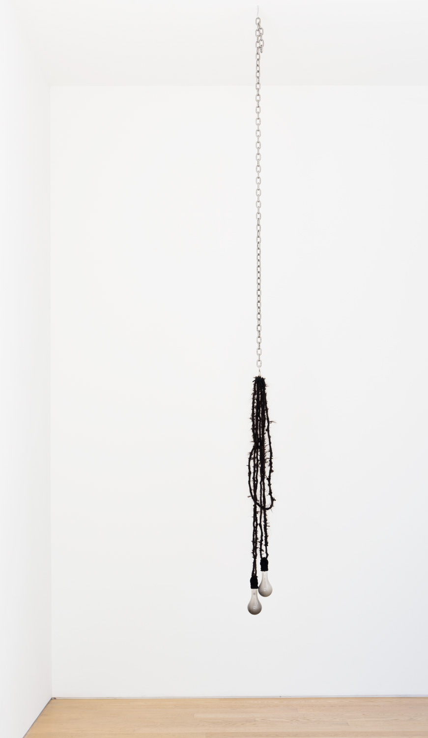 Danny Jauregui   Exhausted  (2016) Human hair, yarn, chain and light bulbs , 8 x 53 x 3in.