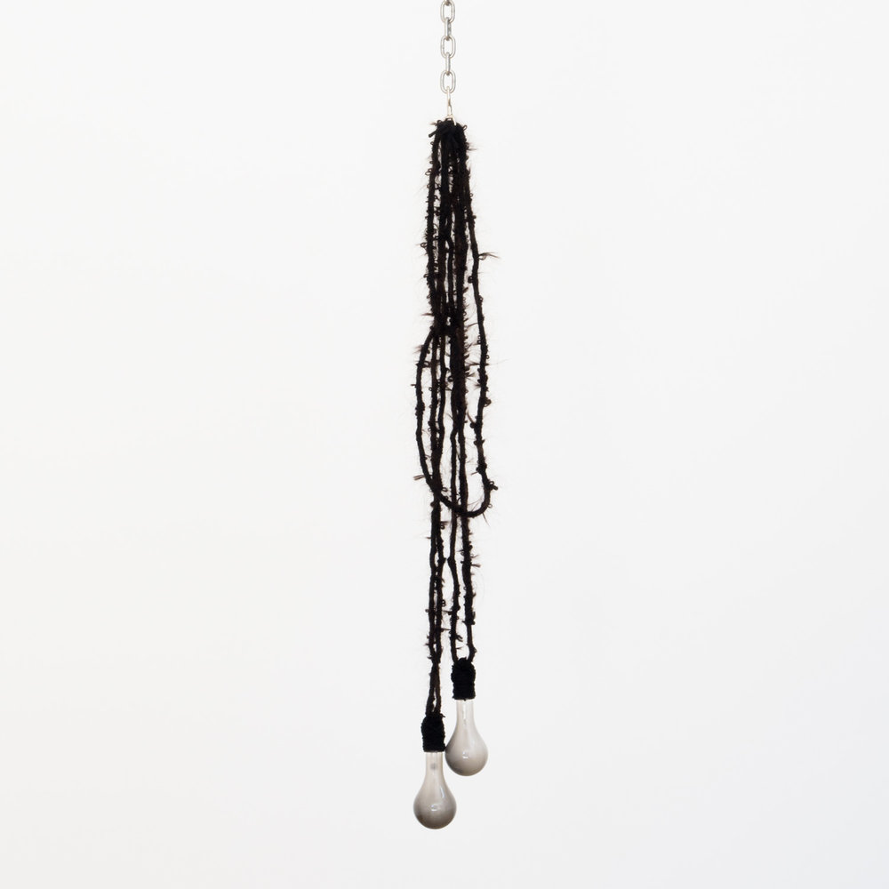 Danny Jauregui   Exhausted (detail)  (2016) Human hair, yarn, chain and light bulbs , 8 x 53 x 3in.