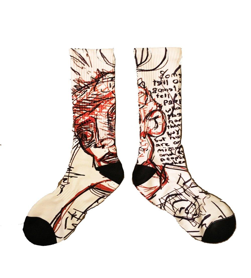 sometimes we tell ourselves stories socks stock photo.jpg