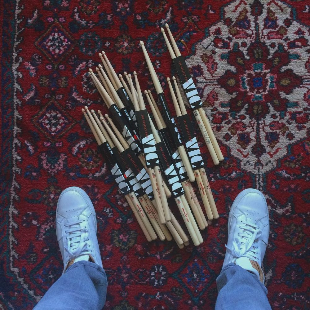 Jake Goldbas wears Greats Brand Sneakers and plays with Vic Firth drumsticks