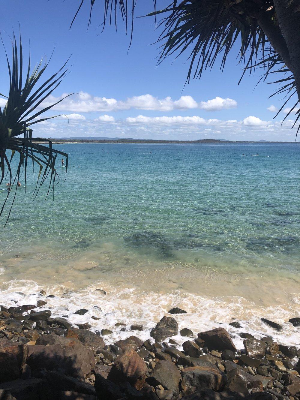 Main Beach, Noosa — crystal clear, 25-degree water.