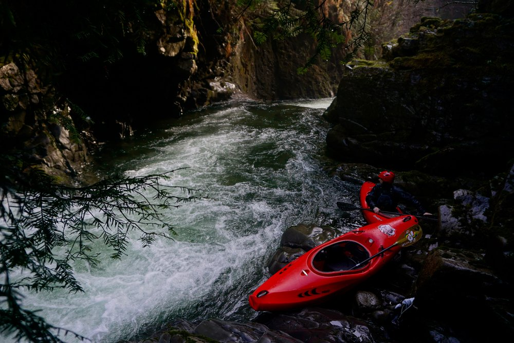 Set up to film paddlers run a double ledge set on the Upper Upper Sitkum (Photo credit: Adam Edwards)