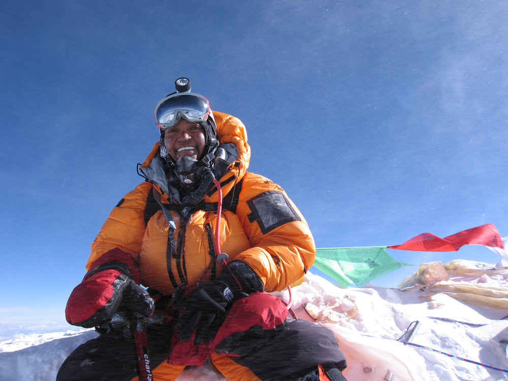 Sophia on the summit of Mount Everest, mask removed.