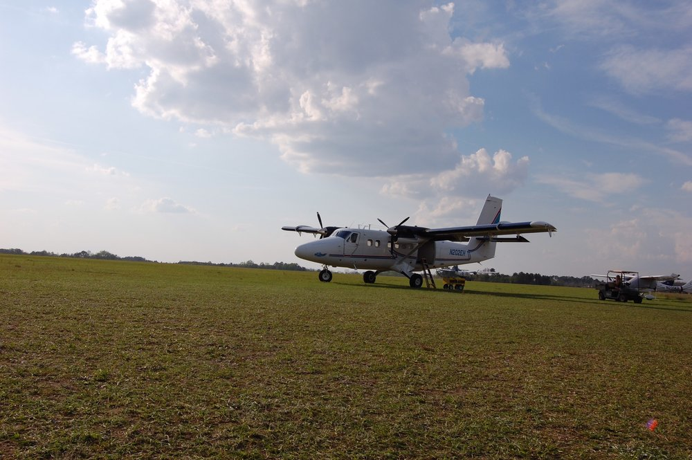 Grass strip runways, camp-outs and bonfires are all a part of the skydiving experience!