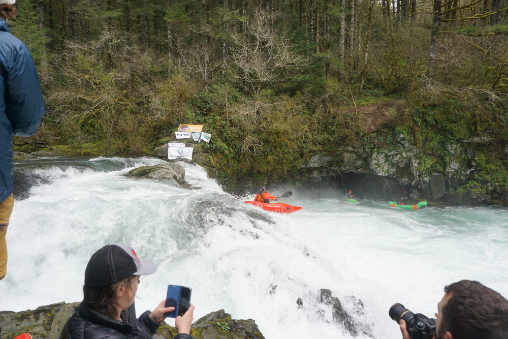 "A paddler runs the center ""auto-boof"" line on Sunset Falls -Photo Adam Edwards"