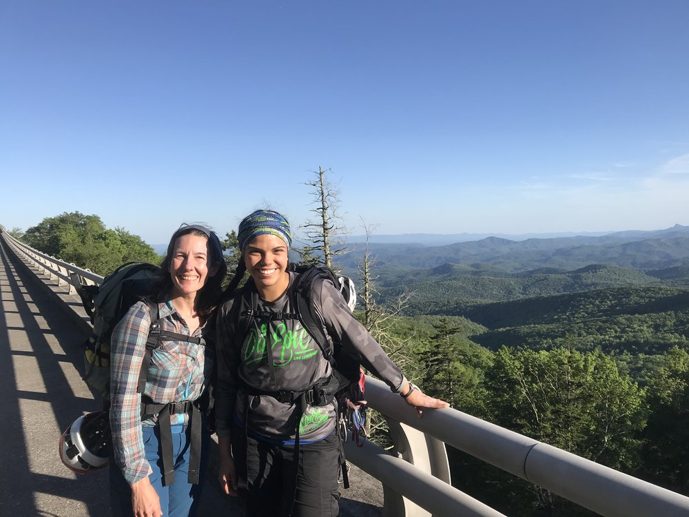 My incredible climbing mentor and ally, Anne McLaughlin, and I coming back from a day of learning trad at Ship Rock in Boone, North Carolina