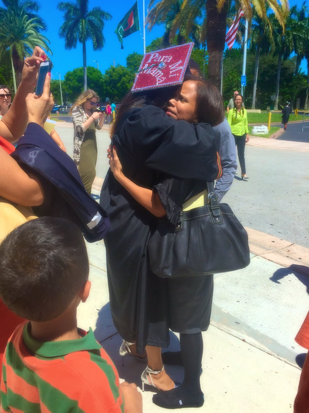 "My mother and I when I graduated college. She was quite surprised to see my graduate cap say ""Para Mi Mama- For My Mom."""