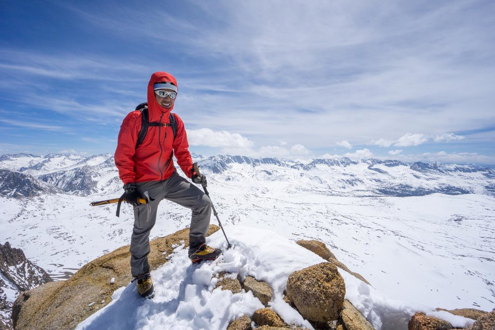 Accidental Mountaineer, Eric Catig poses for a photograph on Mt. Humphreys, a 13,933 ft peak in the Eastern Sierras.  Photo credit:    Gilberto Gil