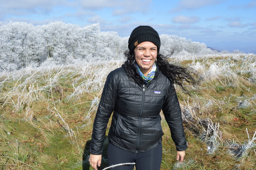 Photo of the author hiking in Max Patch, North Carolina; ancestral land of the Tsalaguwetiyi (Cherokee, East) and Tsoyaha (Yuchi).  Photo Credit: Rachel Skeen.