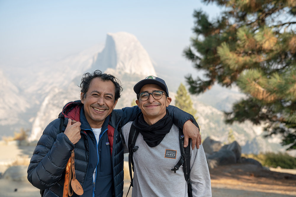 Michael and his dad pose for a photo in Yosemite, CA. 2018