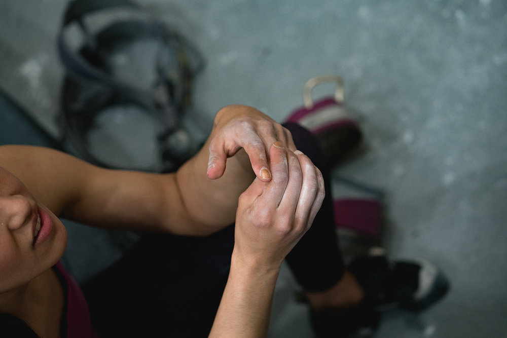 Above: athlete  Isabella Rojas  takes a pause between climbing. Brooklyn Boulders, NY. Photo:  Michael A. Estrada ,  @noyekim