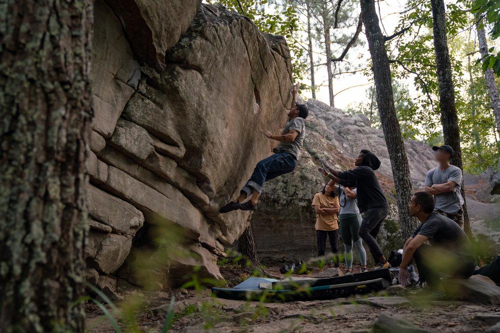 Artist and climber  Hiram Trejo  of  mas.world  magazine takes a leap at Color the Crag.  Photo: Michael A. Estrada