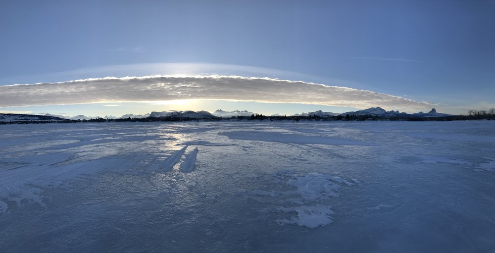A Chinook Arch as seen from Duck Lake.  The Cabin Co is situated just west of the shore.