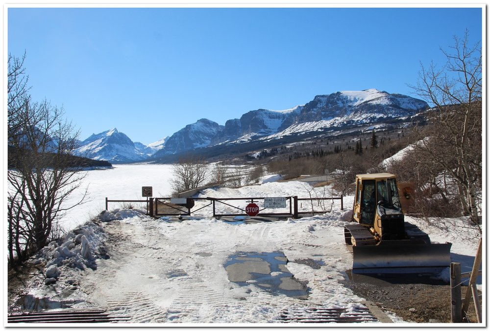 A bulldozer has cleared the drift at Sherburne Dam so that park crews can eventually start working past the gate