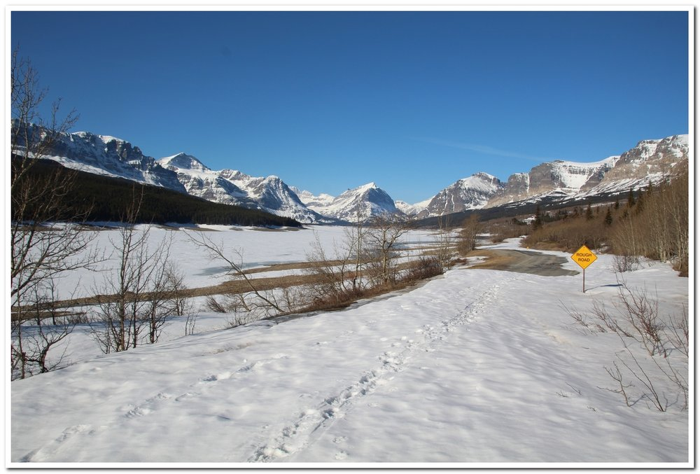 We anticipate this being the smoothest condition of the year for the Many Glacier Road