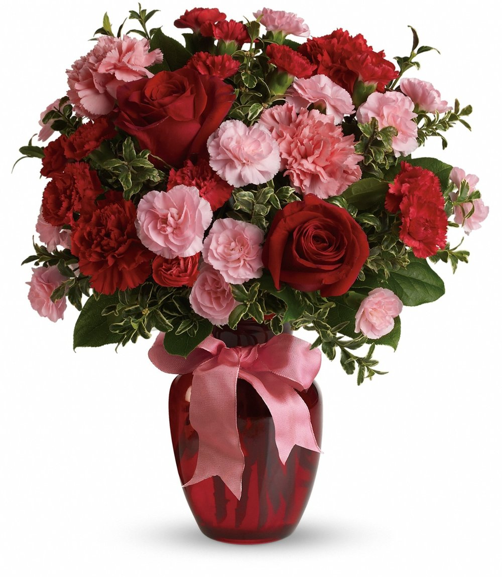 A gorgeous bouquet of long-lasting roses and carnations to make their heart flutter! -