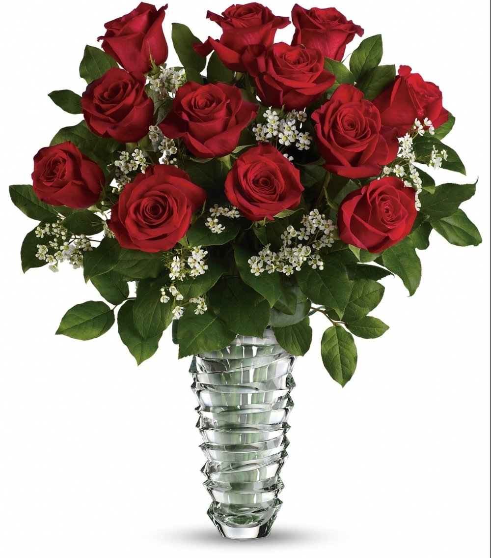 Beautiful dozen long-stemmed red roses in a vase with luscious greens, baby's breath and eucalyptus. - Make it more luxe by choosing 18 or 24 stems of roses!